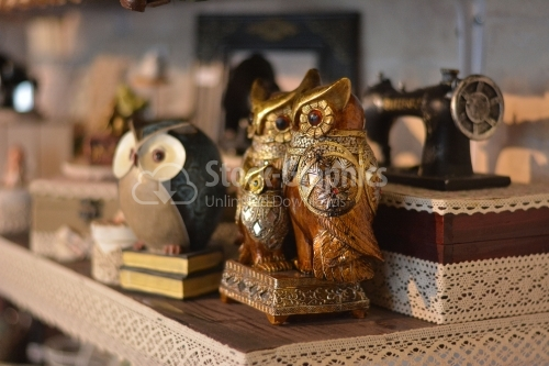Owl statue, trinket as a decoration object on flat background.