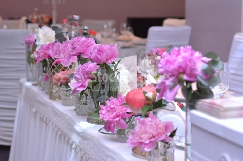 Wedding reception table full of flowers