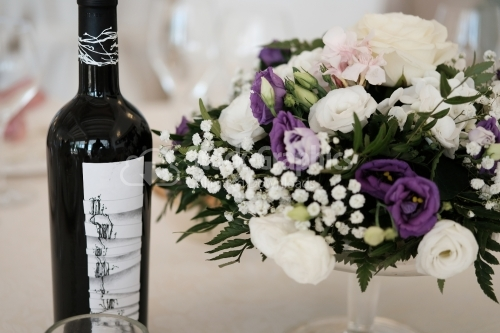 Wine bottle and floral bouquet